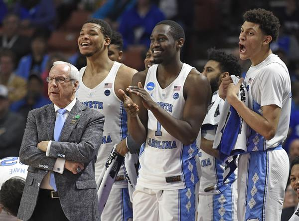 <div class='meta'><div class='origin-logo' data-origin='AP'></div><span class='caption-text' data-credit='AP Photo/Rainier Ehrhardt'>North Carolina head coach Roy Williams, left, and players Kennedy Meeks, Theo Pinson and Justin Jackson react during the second half against Texas Southern</span></div>
