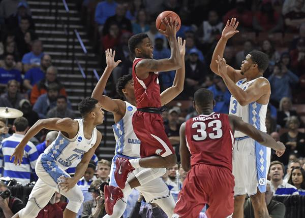 <div class='meta'><div class='origin-logo' data-origin='AP'></div><span class='caption-text' data-credit='AP Photo/Rainier Ehrhardt'>Arkansas' Daryl Macon, center, shoots against North Carolina during the first half in a second-round game of the NCAA men's college basketball tournament in Greenville, S.C.</span></div>