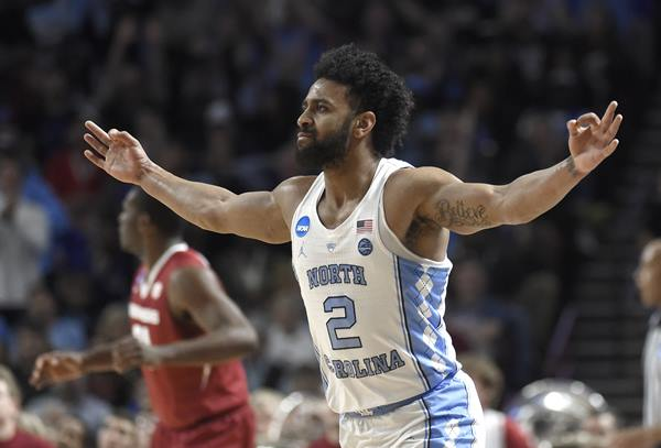 <div class='meta'><div class='origin-logo' data-origin='AP'></div><span class='caption-text' data-credit='AP Photo/Rainier Ehrhardt'>North Carolina's Joel Berry II (2) reacts after making a three-point basket against Arkansas during the first half in a second-round game</span></div>