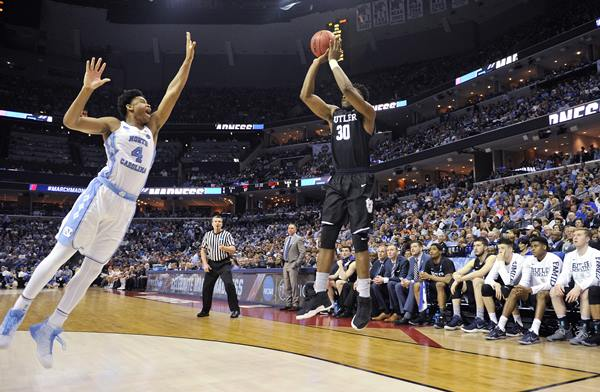 <div class='meta'><div class='origin-logo' data-origin='AP'></div><span class='caption-text' data-credit='AP Photo/Brandon Dill'>Butler forward Kelan Martin shoots against North Carolina forward Isaiah Hicks in the second half of an NCAA college basketball tournament South Regional semifinal game</span></div>