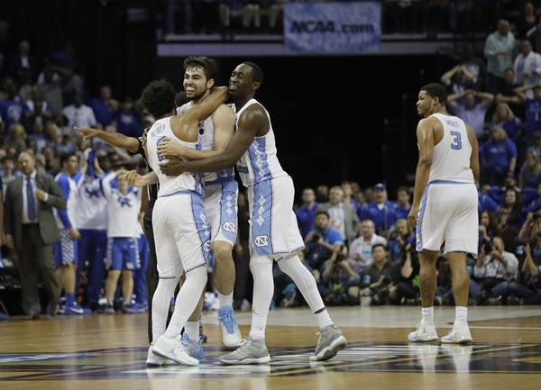 <div class='meta'><div class='origin-logo' data-origin='AP'></div><span class='caption-text' data-credit='AP Photo/Mark Humphrey'>North Carolina forward Luke Maye, second from left, celebrates after shooting the winning basket against Kentucky in the second half of the South Regional final game</span></div>