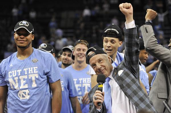 <div class='meta'><div class='origin-logo' data-origin='AP'></div><span class='caption-text' data-credit='AP Photo/Brandon Dill'>North Carolina head coach Roy Williams celebrates with his team after beating Kentucky in the South Regional final game in the NCAA college basketball tournament</span></div>