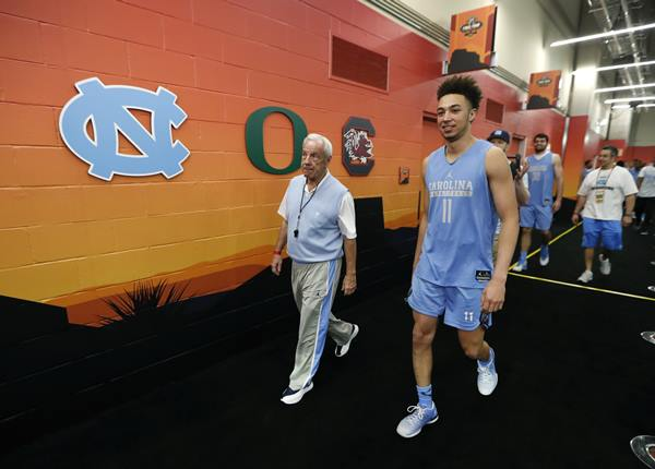 <div class='meta'><div class='origin-logo' data-origin='AP'></div><span class='caption-text' data-credit='AP Photo/Charlie Neibergall'>North Carolina head coach Roy Williams walks to the court with North Carolina forward Shea Rush, right, before a practice session for their NCAA Final Four tournament</span></div>