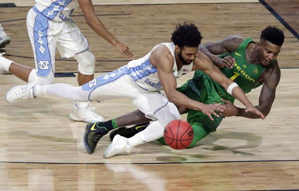 <div class='meta'><div class='origin-logo' data-origin='AP'></div><span class='caption-text' data-credit='AP Photo/Matt York'>Oregon's Jordan Bell (1) chases a loose ball against North Carolina's Joel Berry II during the second half in the semifinals of the Final Four NCAA college basketball tournament</span></div>