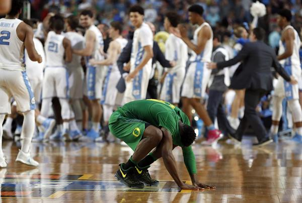 <div class='meta'><div class='origin-logo' data-origin='AP'></div><span class='caption-text' data-credit='AP Photo/Charlie Neibergall'>Oregon's Dylan Ennis reacts after the semifinals of the Final Four NCAA college basketball tournament against North Carolina</span></div>