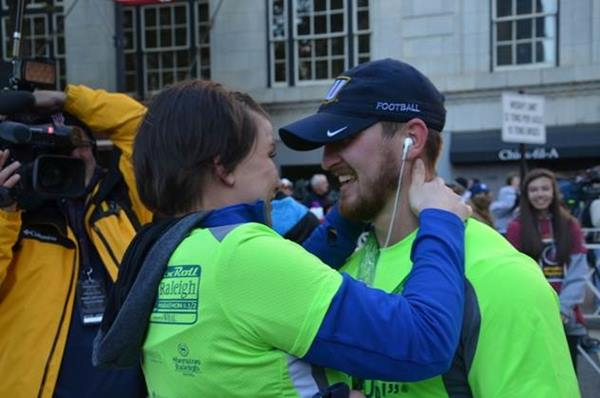 <div class='meta'><div class='origin-logo' data-origin='none'></div><span class='caption-text' data-credit=''>Carrie and Brent after he finished the race</span></div>
