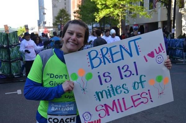 <div class='meta'><div class='origin-logo' data-origin='none'></div><span class='caption-text' data-credit=''>Carrie cheers Brent on at the marathon</span></div>