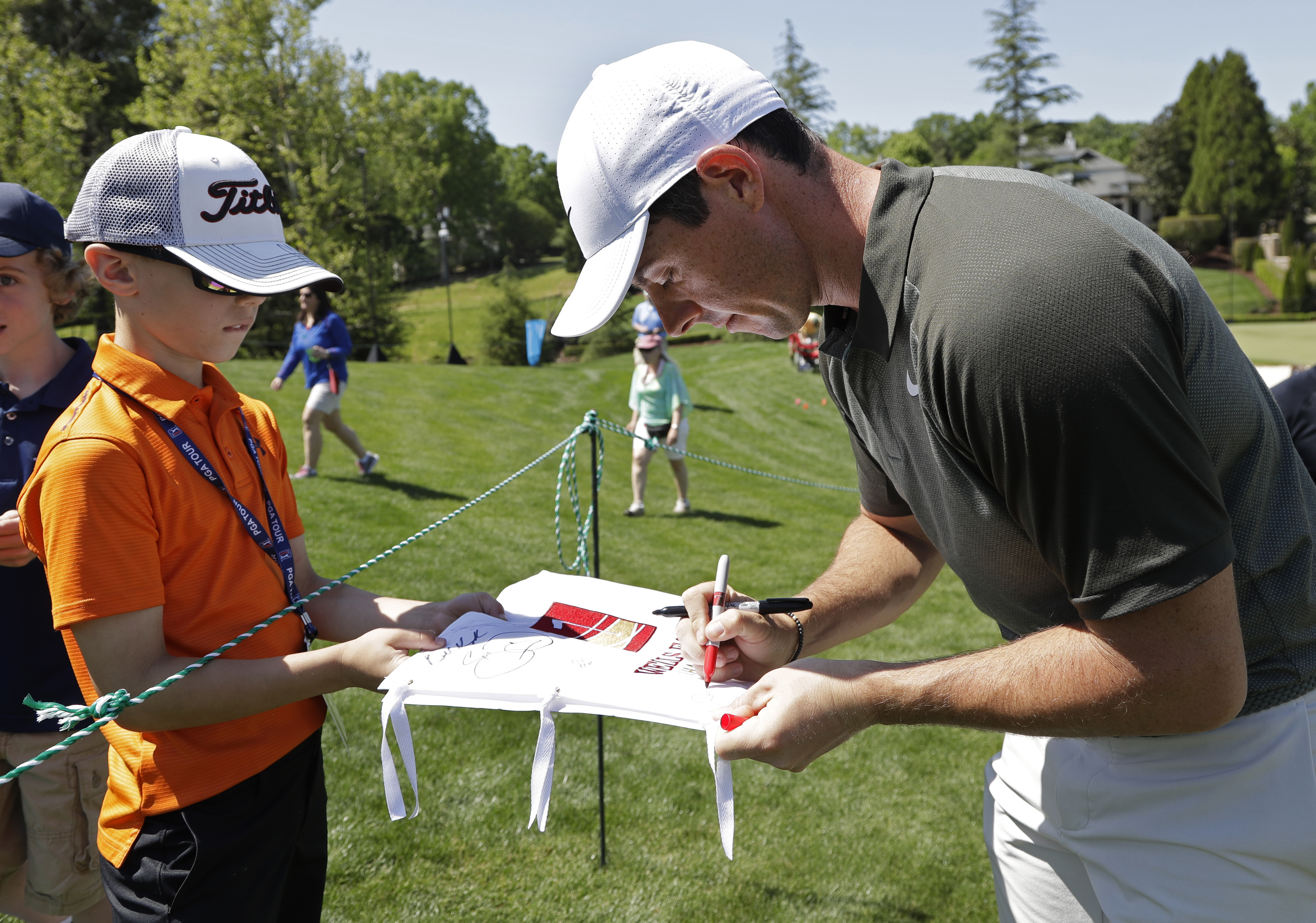 <div class='meta'><div class='origin-logo' data-origin='AP'></div><span class='caption-text' data-credit='Chuck Burton'>Rory McIlroy, of Northern Ireland, signs an autograph for a fan on the seventh hole.</span></div>