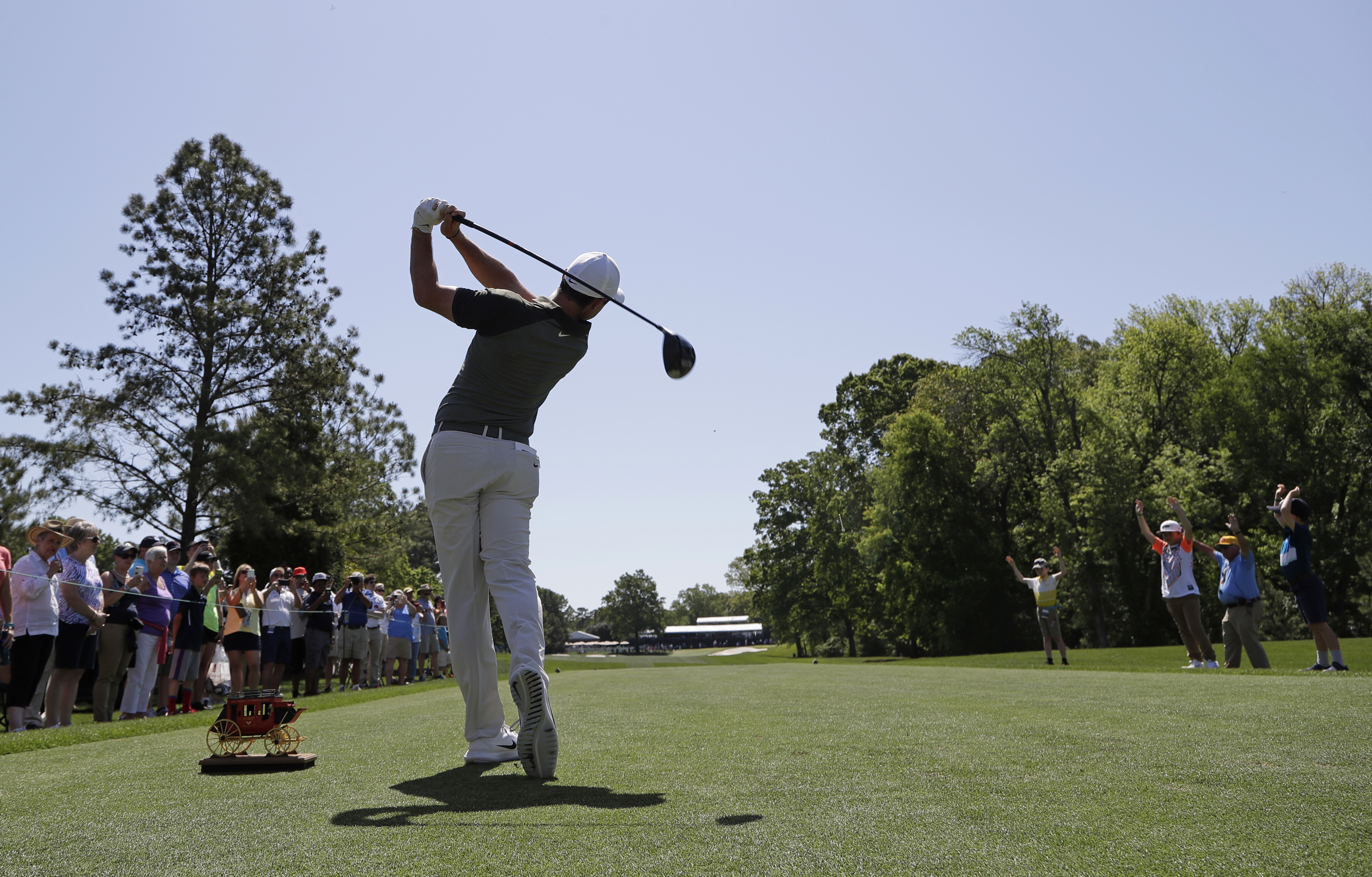 <div class='meta'><div class='origin-logo' data-origin='AP'></div><span class='caption-text' data-credit='Chuck Burton'>Rory McIlroy, of Northern Ireland, hits his tee shot on the eighth hole during the pro-am.</span></div>