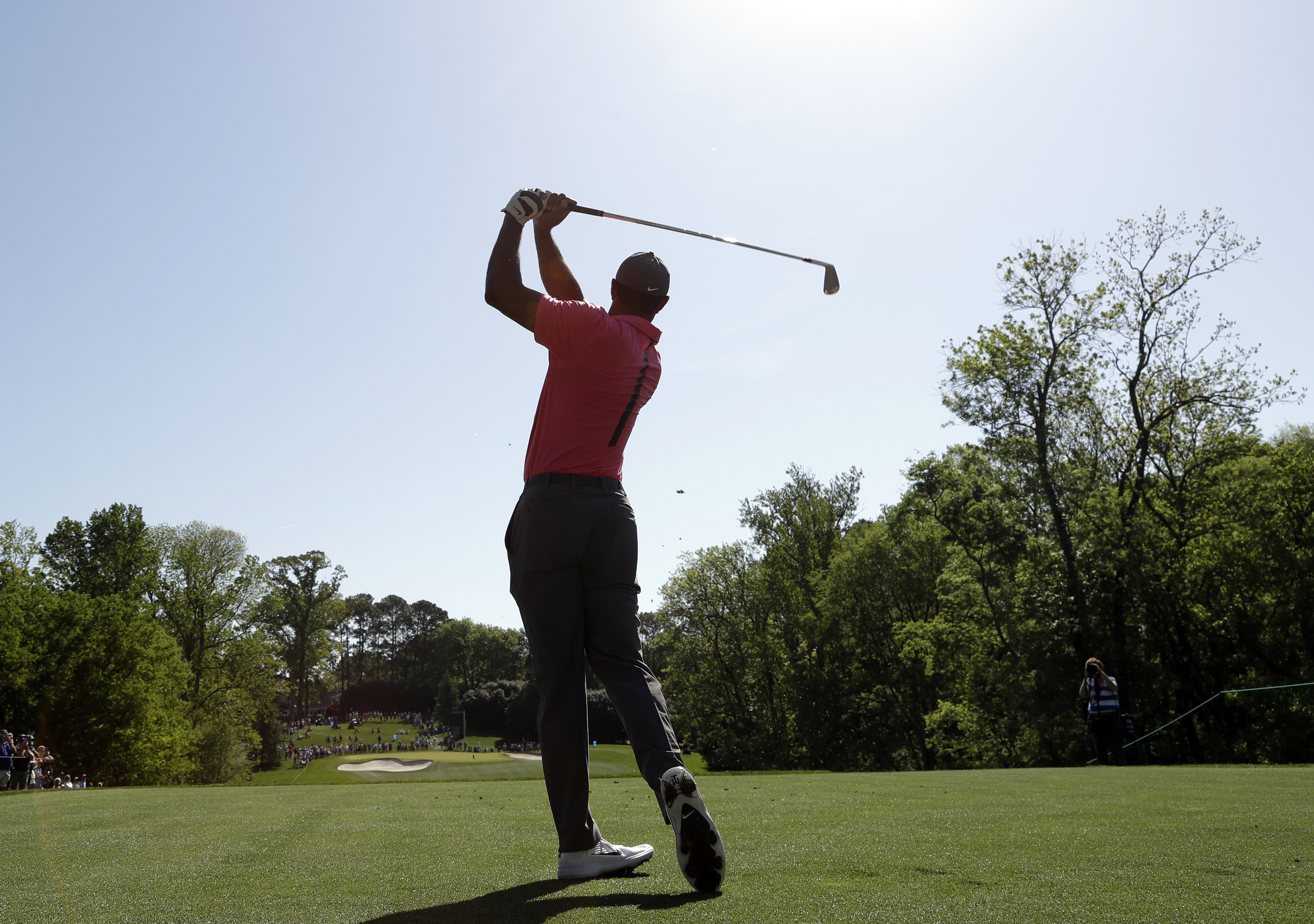 <div class='meta'><div class='origin-logo' data-origin='AP'></div><span class='caption-text' data-credit='Chuck Burton'>Tiger Woods watches his tee shot on the 13th hole during the pro-am of the Wells Fargo Championship golf tournament at Quail Hollow Club in Charlotte.</span></div>