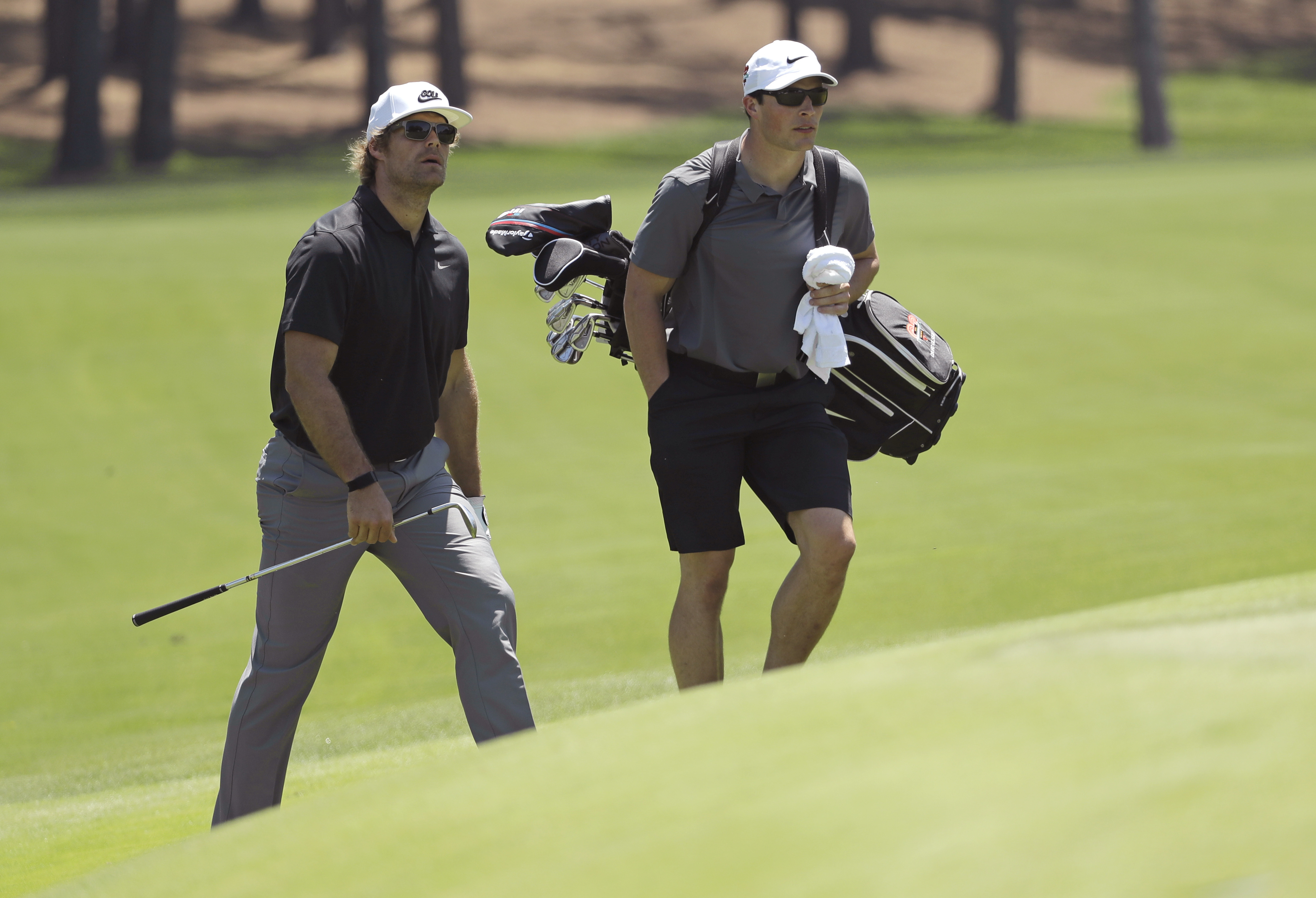 <div class='meta'><div class='origin-logo' data-origin='AP'></div><span class='caption-text' data-credit='Chuck Burton'>Carolina Panthers' Greg Olsen, left, and his caddie, Carolina Panthers' Luke Kuechly, right, walk to the second green during the pro-am.</span></div>