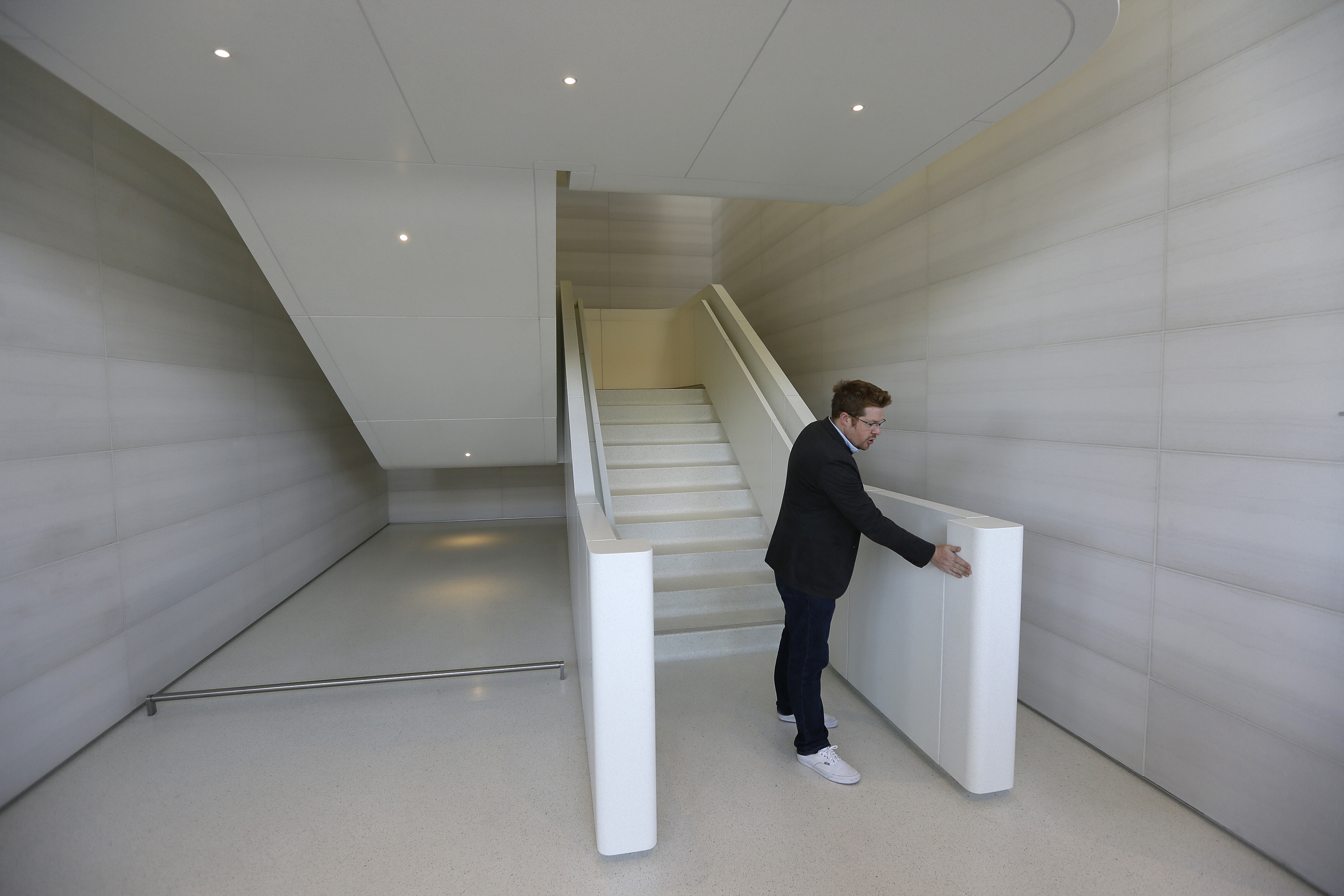 <div class='meta'><div class='origin-logo' data-origin='none'></div><span class='caption-text' data-credit='AP'>An Apple employee shows off a stairway during the grand opening of the Apple Park Visitor Center Friday, Nov. 17, 2017, in Cupertino, Calif. (AP Photo/Eric Risberg)</span></div>