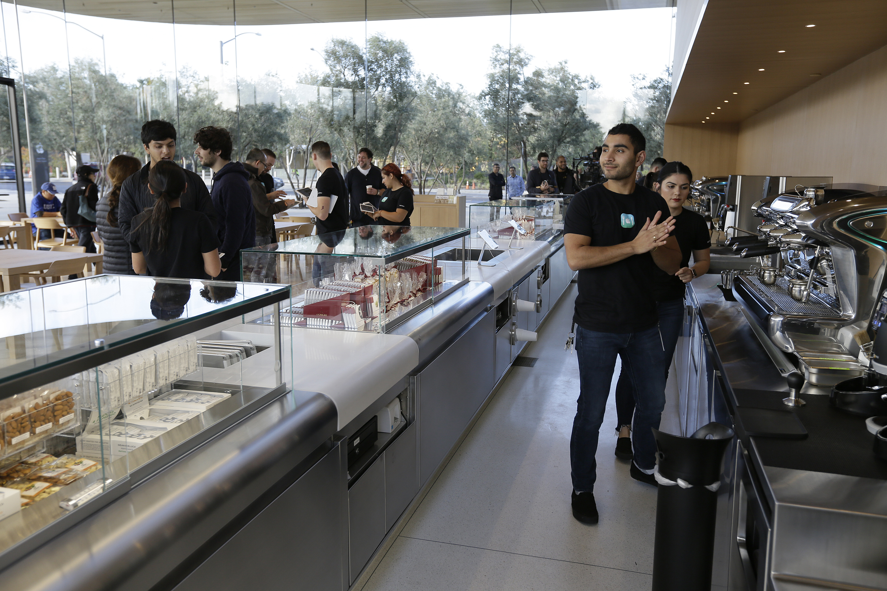<div class='meta'><div class='origin-logo' data-origin='none'></div><span class='caption-text' data-credit='AP'>Shown is the cafe during the grand opening of the Apple Park Visitor Center Friday, Nov. 17, 2017, in Cupertino, Calif. (AP Photo/Eric Risberg)</span></div>