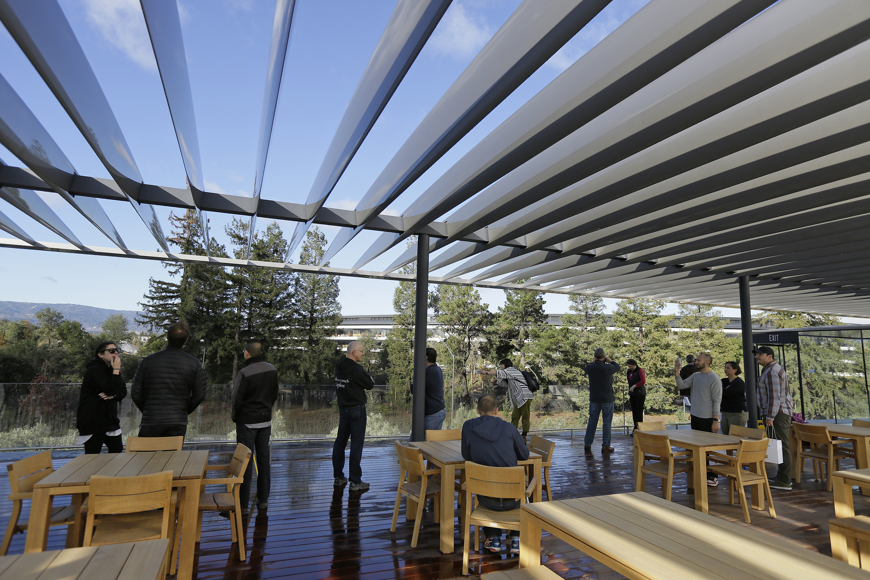 <div class='meta'><div class='origin-logo' data-origin='none'></div><span class='caption-text' data-credit='AP'>People stand on a rooftop terrace with the main building in the background during the grand opening of the Apple Park Visitor Center Friday, Nov. 17</span></div>