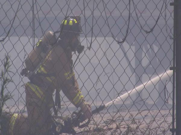 <div class='meta'><div class='origin-logo' data-origin='WTVD'></div><span class='caption-text' data-credit='Shawn Replogle'>Firefighters battle a huge factory fire in Henderson.</span></div>