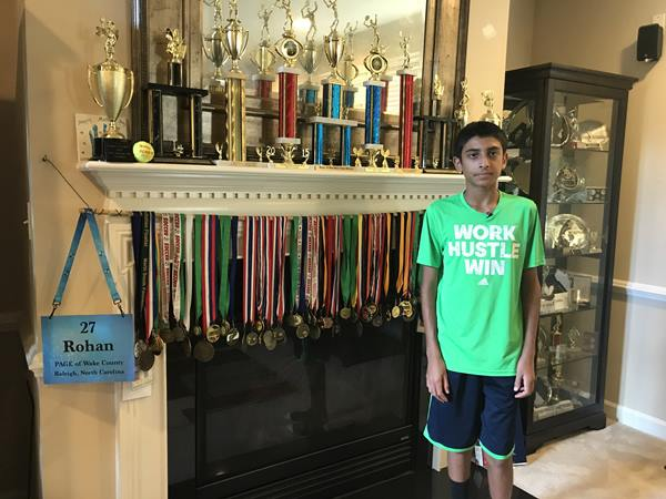 <div class='meta'><div class='origin-logo' data-origin='WTVD'></div><span class='caption-text' data-credit='Ngozi Ekeledo'>Rohan Sachdev stands in front of the fruits of his hard work in the classroom and on the tennis court.</span></div>