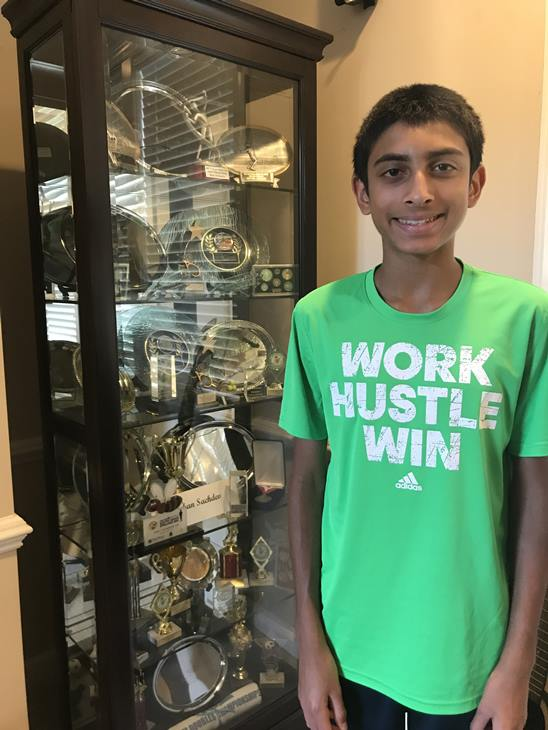 <div class='meta'><div class='origin-logo' data-origin='WTVD'></div><span class='caption-text' data-credit='Ngozi Ekeledo'>Rohan Sachdev in front of a trophy case at home.</span></div>
