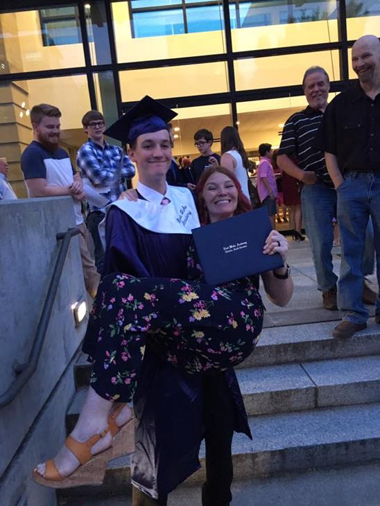 "<div class=""meta image-caption""><div class=""origin-logo origin-image none""><span>none</span></div><span class=""caption-text"">My oldest son, Alex graduated from East Wake Academy! We did a reenactment in this picture, except I was holding him at my graduation in 2000. (Brandi Bunn)</span></div>"