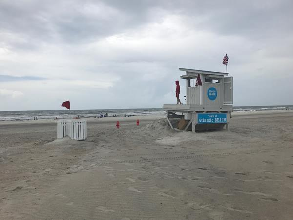 <div class='meta'><div class='origin-logo' data-origin='none'></div><span class='caption-text' data-credit='Credit: Elania Athans'>High surf danger prompts warnings for North Carolina beaches</span></div>