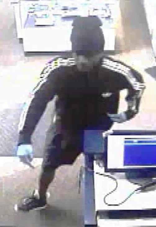 <div class='meta'><div class='origin-logo' data-origin='WTVD'></div><span class='caption-text' data-credit='Durham Police Department'>A suspect in the Friendly Pawn robbery.</span></div>