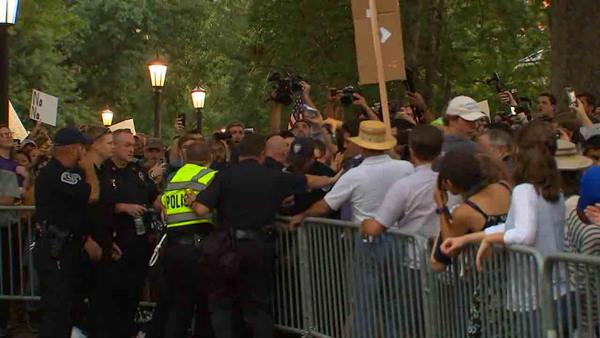 <div class='meta'><div class='origin-logo' data-origin='WTVD'></div><span class='caption-text' data-credit=''>Protesters gather at the Silent Sam statue on Tuesday.</span></div>