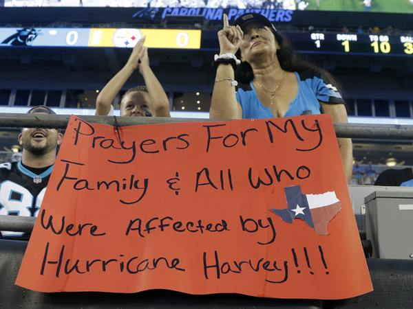 "<div class=""meta image-caption""><div class=""origin-logo origin-image ap""><span>AP</span></div><span class=""caption-text"">A Panthers fan shows her support for those affected by Hurricane Harvey. (Mike McCarn)</span></div>"