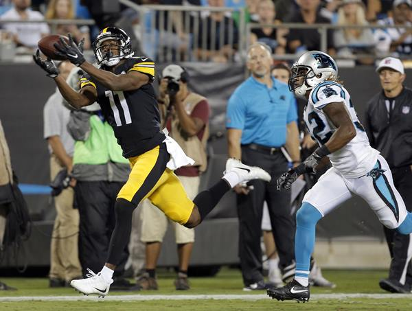 "<div class=""meta image-caption""><div class=""origin-logo origin-image ap""><span>AP</span></div><span class=""caption-text"">Pittsburgh Steelers' Justin Hunter catches a touchdown pass against Carolina Panthers' Cole Luke. (Mike McCarn)</span></div>"