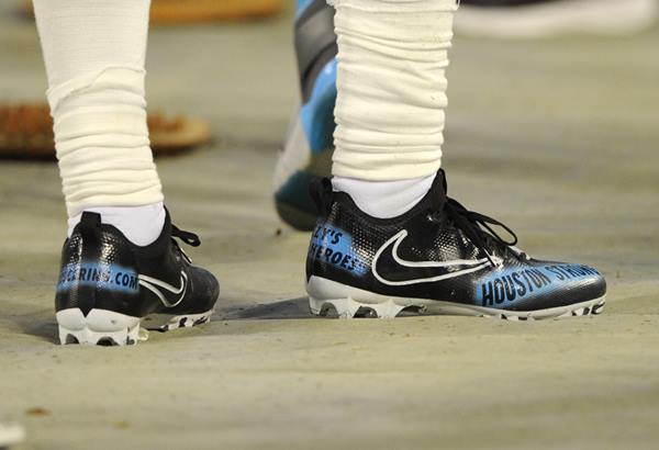 "<div class=""meta image-caption""><div class=""origin-logo origin-image ap""><span>AP</span></div><span class=""caption-text"">Carolina Panthers running back Fozzy Whittaker, a Houston native, shows support on his shoes for his Harvey-ravaged hometown. (Mike McCarn)</span></div>"