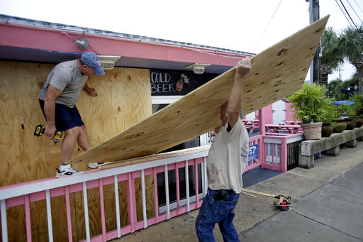 <div class='meta'><div class='origin-logo' data-origin='none'></div><span class='caption-text' data-credit=''>Tim Allen, left, and Joe Allen board up the front of an outdoor bar as they prepared for Hermine in Cedar Key, Fla. (AP Photo/John Raoux)</span></div>