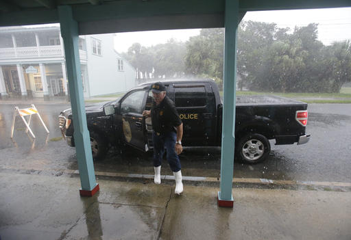 <div class='meta'><div class='origin-logo' data-origin='none'></div><span class='caption-text' data-credit=''>Cedar Key police chief Virgil Sandlin checks on the downtown area as Hermine neared the Florida coast in Cedar Key, Fla.  (AP Photo/John Raoux)</span></div>