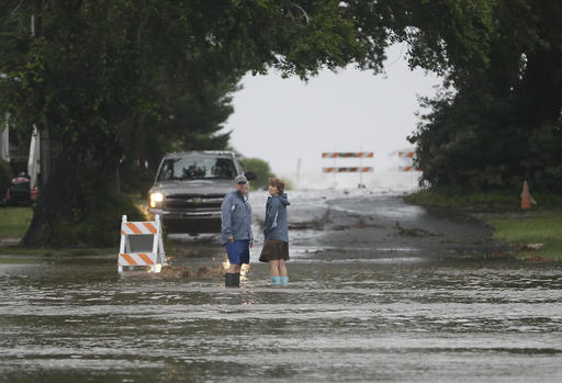 <div class='meta'><div class='origin-logo' data-origin='none'></div><span class='caption-text' data-credit=''>Residents check on a flooded street before turning back as Hermine neared the Florida coast in Cedar Key, Fla.  (AP Photo/John Raoux)</span></div>