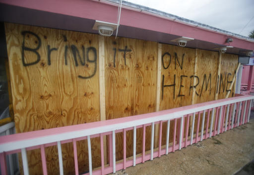 <div class='meta'><div class='origin-logo' data-origin='none'></div><span class='caption-text' data-credit=''>A hand painted sign on a boarded up bar is seen as Hermine neared the Florida coast in Cedar Key, Fla. (AP Photo/John Raoux)</span></div>