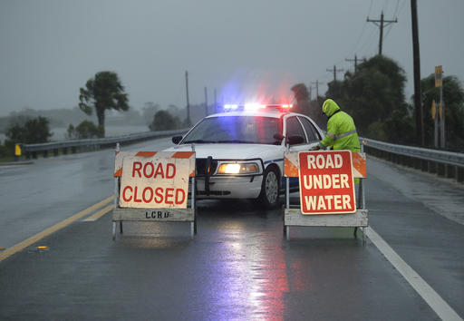 <div class='meta'><div class='origin-logo' data-origin='none'></div><span class='caption-text' data-credit=''>Police block the road entering Cedar Key, Fla., as Hermine neared the Florida coast  (AP Photo/John Raoux)</span></div>