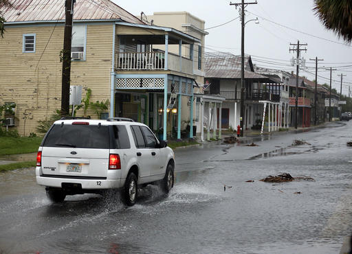 <div class='meta'><div class='origin-logo' data-origin='none'></div><span class='caption-text' data-credit=''>A vehicle makes it way through the downtown area of Cedar Key, Fla., as Hermine neared the Florida coast (AP Photo/John Raoux)</span></div>