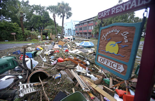 <div class='meta'><div class='origin-logo' data-origin='none'></div><span class='caption-text' data-credit=''>A street is blocked from debris washed up from the tidal surge of Hurricane Hermine in Cedar Key, Fla. (AP Photo/John Raoux)</span></div>