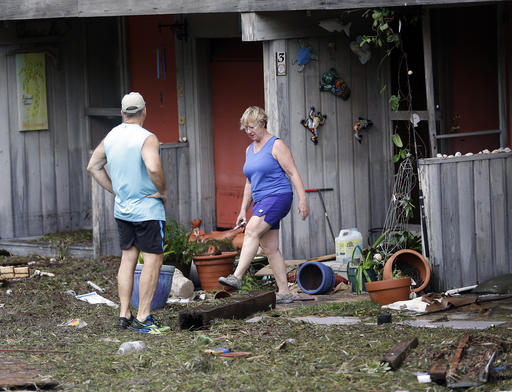 <div class='meta'><div class='origin-logo' data-origin='none'></div><span class='caption-text' data-credit=''>Residents check on damage after Hurricane Hermine passed through Cedar Key, Fla. (AP Photo/John Raoux)</span></div>
