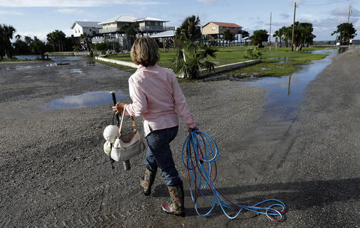 <div class='meta'><div class='origin-logo' data-origin='none'></div><span class='caption-text' data-credit=''>Nancy Geohagen picks up some of her belongings after her home was damaged by Hurricane Hermine in Florida. (AP Photo/Chris O'Meara)</span></div>