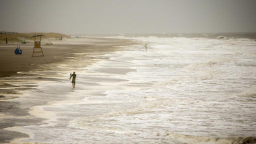 <div class='meta'><div class='origin-logo' data-origin='none'></div><span class='caption-text' data-credit=''>A surfer walks the beach while looking for waves from the surge of Hurricane Hermine off the coast of Tybee Island, Ga. (AP Photo/Stephen B. Morton)</span></div>