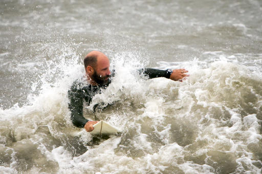 <div class='meta'><div class='origin-logo' data-origin='none'></div><span class='caption-text' data-credit=''>A surfer looks for a wave from the surge of Hurricane Hermineoff the coast of Tybee Island, Ga.  (AP Photo/Stephen B. Morton)</span></div>