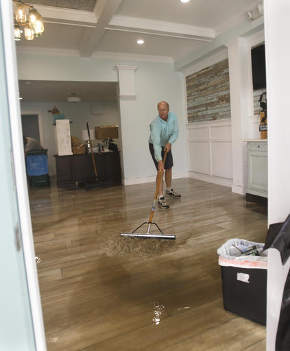 <div class='meta'><div class='origin-logo' data-origin='none'></div><span class='caption-text' data-credit=''>Shawn Stephenson clears water from a real estate office that was flooded by Hurricane Hermine in Cedar Key, Fla. (AP Photo/John Raoux)</span></div>