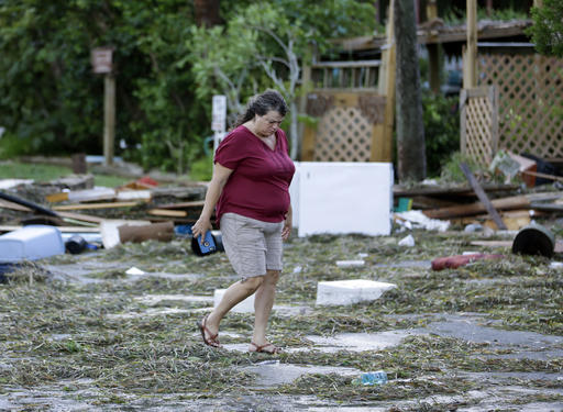 <div class='meta'><div class='origin-logo' data-origin='none'></div><span class='caption-text' data-credit=''>A resident checks on damage from Hurricane Hermine in Cedar Key, Fla. (AP Photo/John Raoux)</span></div>