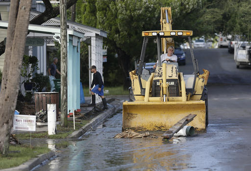 <div class='meta'><div class='origin-logo' data-origin='none'></div><span class='caption-text' data-credit=''>A front end loader clears debris from the street after Hurricane Hermine passed through in Cedar Key, Fla. (AP Photo/John Raoux)</span></div>