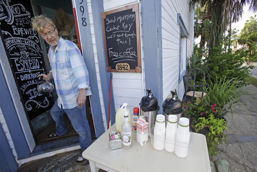 <div class='meta'><div class='origin-logo' data-origin='none'></div><span class='caption-text' data-credit=''>Martin Kemp offers free coffee outside his coffee shop to residents and local business owners after Hurricane Hermine flooded his shop in Cedar Key, Fla. (AP Photo/John Raoux)</span></div>