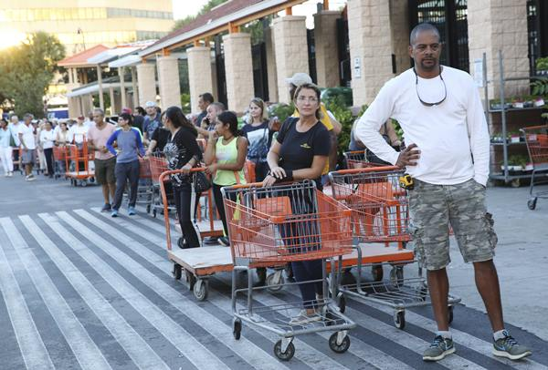 "<div class=""meta image-caption""><div class=""origin-logo origin-image ap""><span>AP</span></div><span class=""caption-text"">Eduardo Soriano of Miami, waits in a line since dawn to purchase plywood sheets at a Home Depot store in North Miami, Fla., Wednesday. (Marta Lavandier)</span></div>"