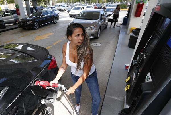 "<div class=""meta image-caption""><div class=""origin-logo origin-image ap""><span>AP</span></div><span class=""caption-text"">Carli Andrade of Miami, pumps gas at a Costco gas station, Wednesday, Sept. 6, 2017, in North Miami, Fla. (Wilfredo Lee)</span></div>"