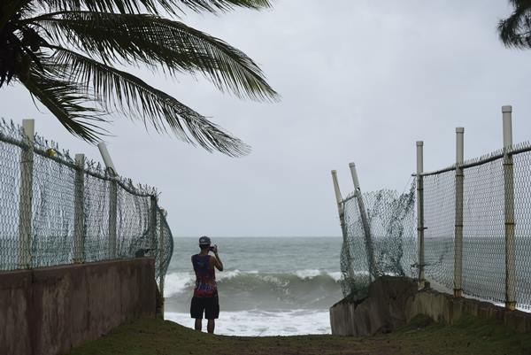 "<div class=""meta image-caption""><div class=""origin-logo origin-image ap""><span>AP</span></div><span class=""caption-text"">A man photographs the ocean before the arrival of Hurricane Irma, in luquillo, Puerto Rico, Wednesday, Sept. 6, 2017. (Carlos Giusti)</span></div>"