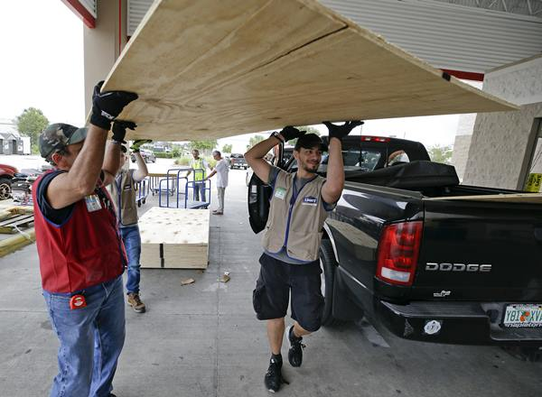 "<div class=""meta image-caption""><div class=""origin-logo origin-image ap""><span>AP</span></div><span class=""caption-text"">Employees of a building supply store load sheets of plywood for a customer in the back of a truck during preparation for Hurricane Irma, Wednesday, Sept. 6, 2017, in Orlando, Fla. (John Raoux)</span></div>"