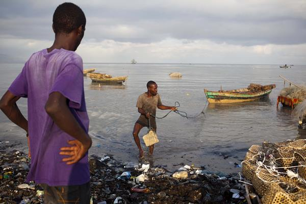 "<div class=""meta image-caption""><div class=""origin-logo origin-image ap""><span>AP</span></div><span class=""caption-text"">A fisherman brings his boat ashore as a precaution against Hurricane Irma, in the seaside slum of Port-au-Prince, Haiti, Wednesday, Sept. 6, 2017. (Dieu Nalio Chery)</span></div>"
