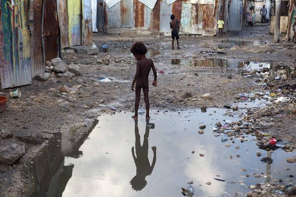 "<div class=""meta image-caption""><div class=""origin-logo origin-image ap""><span>AP</span></div><span class=""caption-text"">A child plays in a puddle in Port-au-Prince, Haiti, Wednesday, Sept. 6, 2017. (Dieu Nalio Chery)</span></div>"