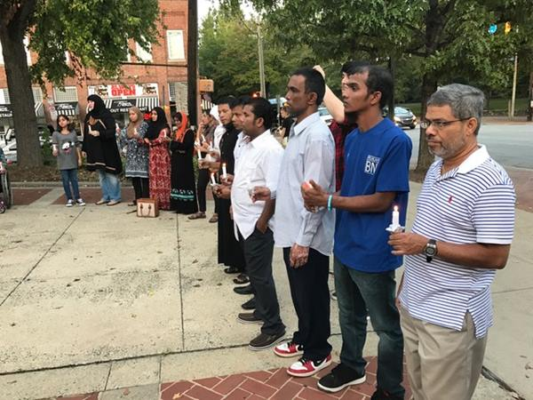 <div class='meta'><div class='origin-logo' data-origin='WTVD'></div><span class='caption-text' data-credit='Dave Anderson'>A vigil for held in Chapel Hill on Monday night to raise awareness of ethnic violence in Myanmar.</span></div>
